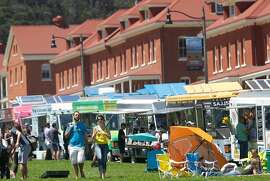 Food trucks line the Main Post of the Presidio at Off the Grid Sunday picnic in San Francisco.