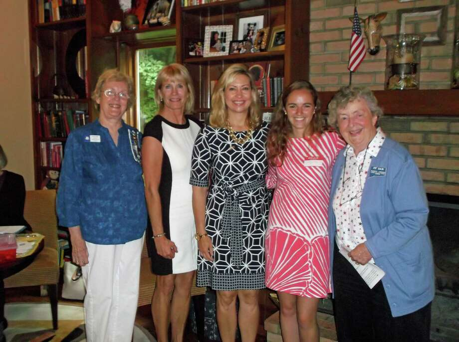 Over the past year the Hannah Benedict Carter Chapter, NSDAR, of New Canaan, accepted 21 new members. The chapter inducted three more members at the year-end meeting June 12. From left, chapter regent Diane Wells; new members Nancy Neuser, Lisa Melland and Bridget Falcone; and chapter chaplain Nancy Cross. Photo: Contributed Photo, Contributed / New Canaan News
