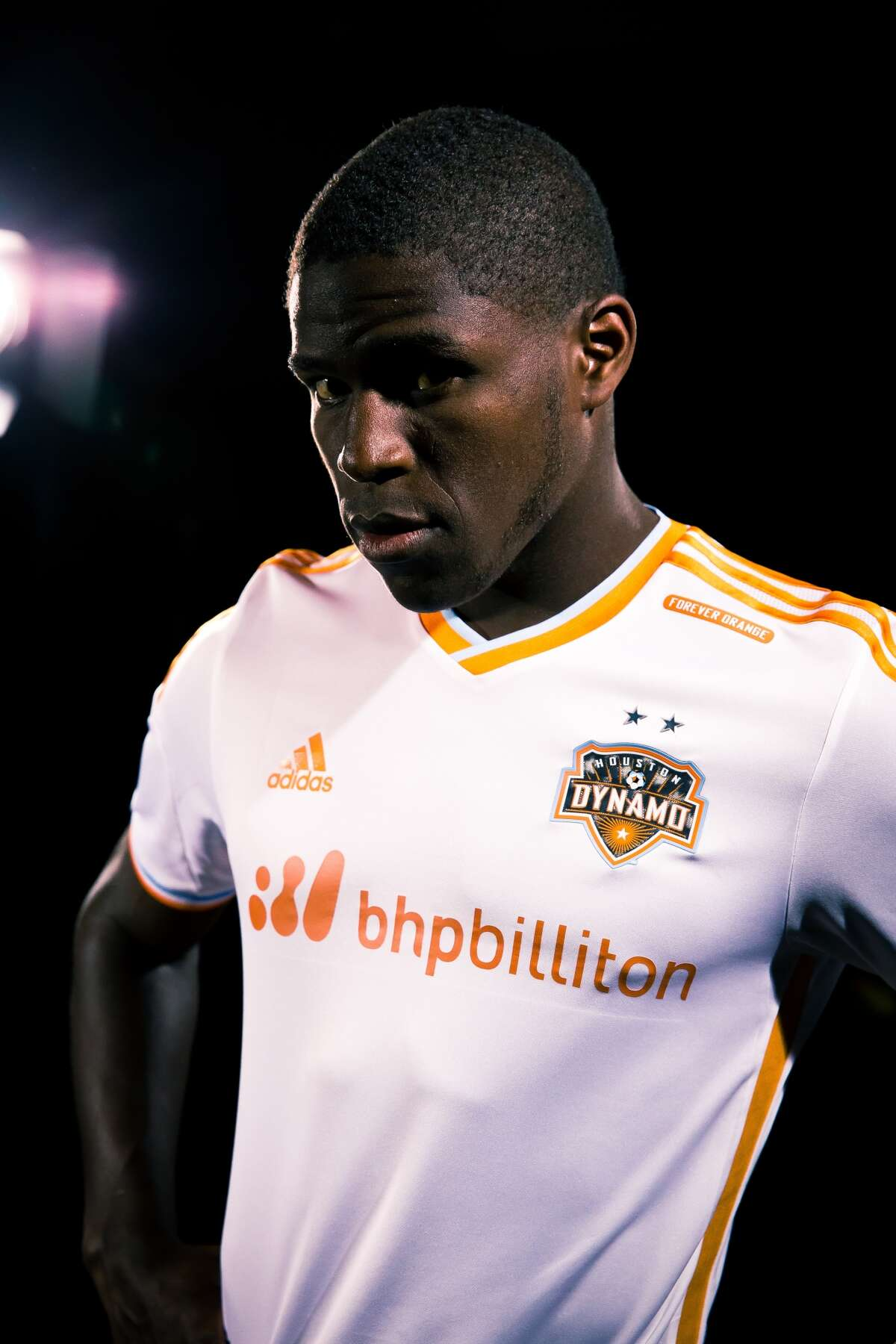 Dynamo defender Kofi Sarkodie shows off the team's new partnership with BHP Billiton.(Anthony Vasser/Houston Dynamo)