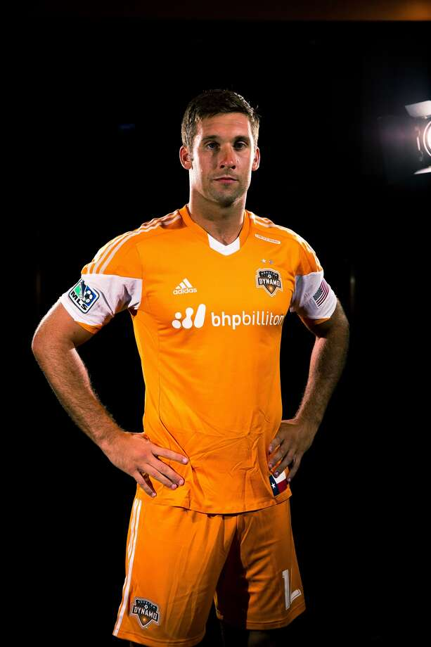 Dynamo forward Will Bruin shows off the team's new partnership with BHP Billiton.(Anthony Vasser/Houston Dynamo)