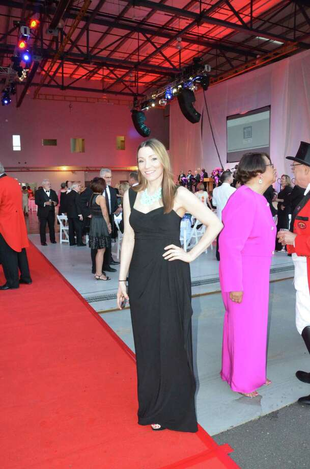 Amy Palmesi-Bentzig of Trumbull came decked out in a black, floor-length gown to The Ringmaster's Ball at Volo Aviation at Sikorsky Memorial Airport in June. Photo: Victor Eng, Contributed Photo / Stamford Advocate
