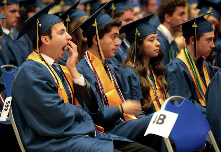 Keller quintuplet George Diaz yawns as he, siblings John and Maria, and hundreds of their classmates wait in a practice gym for the Keller High School's graduation ceremony in Arlington, Texas on Saturday, May 31, 2014.  Diplomas in hand, the quintuplets, born July 14, 1996, in Houston to Enna Sr. and Jorge Diaz, will move on to increase the enrollment at the University of North Texas in Denton. (AP Photo/The Fort Worth Star-Telegram, Ian McVea)  MAGS OUT; (FORT WORTH WEEKLY, 360 WEST); INTERNET OUT Photo: Ian McVea, MBI / The Fort Worth Star-Telegram