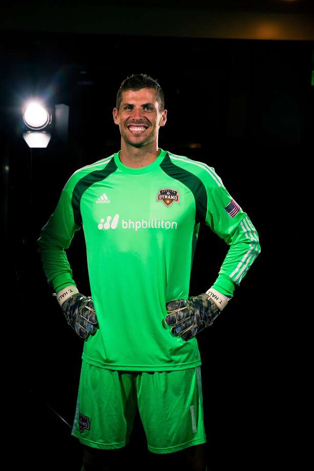 Dynamo goalkeeper Tally Hall shows off the team's new partnership with BHP Billiton.(Anthony Vasser/Houston Dynamo)