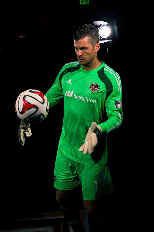 Dynamo goalkeeper Tally Hall shows off the team's new partnership with BHP Billiton.(Anthony Vasser/Houston Dynamo)