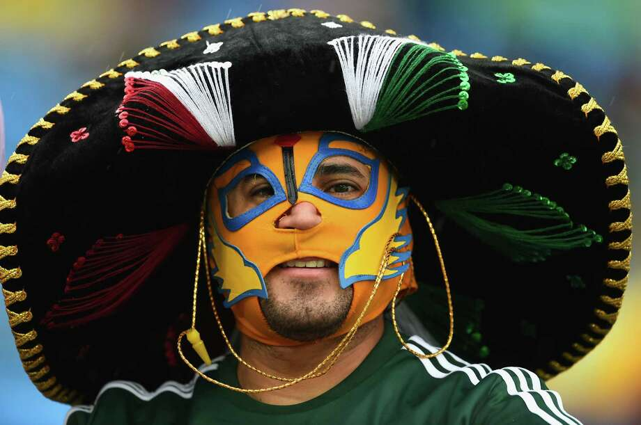 NATAL, BRAZIL - JUNE 13:  A Mexico fan looks on through the rain prior to the 2014 FIFA World Cup Brazil Group A match between Mexico and Cameroon at Estadio das Dunas on June 13, 2014 in Natal, Brazil. Photo: Matthias Hangst, Getty Images / 2014 Getty Images