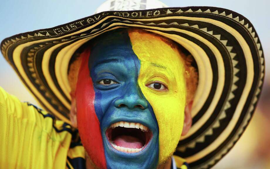 BELO HORIZONTE, BRAZIL - JUNE 14:  A Colombia fan with a painted face enjoys the atmosphere prior to the 2014 FIFA World Cup Brazil Group C match between Colombia and Greece at Estadio Mineirao on June 14, 2014 in Belo Horizonte, Brazil. Photo: Paul Gilham, Getty Images / 2014 Getty Images