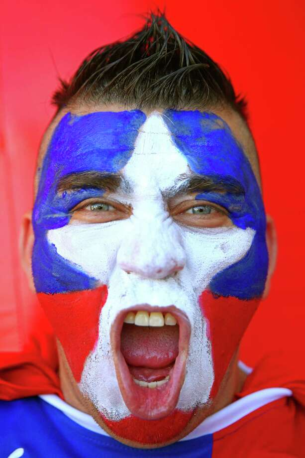 CUIABA, BRAZIL - JUNE 13:  A Chile fan enjoys the atmosphere prior to the 2014 FIFA World Cup Brazil Group B match between Chile and Australia at Arena Pantanal on June 13, 2014 in Cuiaba, Brazil. Photo: Cameron Spencer, Getty Images / 2014 Getty Images