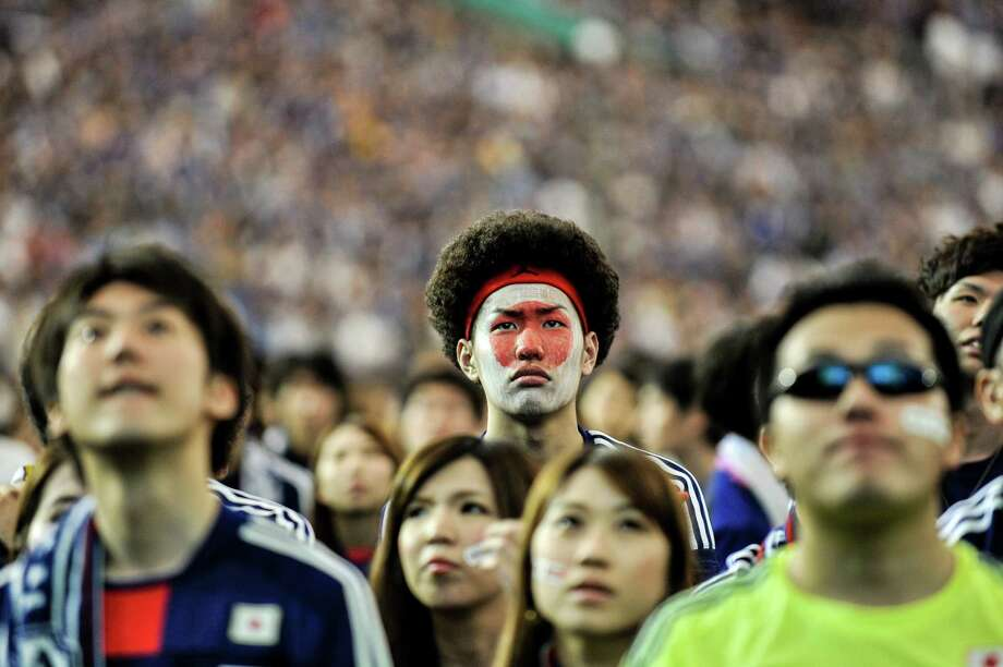 TOKYO, JAPAN - JUNE 15:  Japanese fans react after Japan is defeated during the 2014 FIFA World Cup match between Japan and Cote d'Ivoire during the public viewing event at Tokyo Dome on June 15, 2014 in Tokyo, Japan. Photo: Keith Tsuji, Getty Images / 2014 Getty Images
