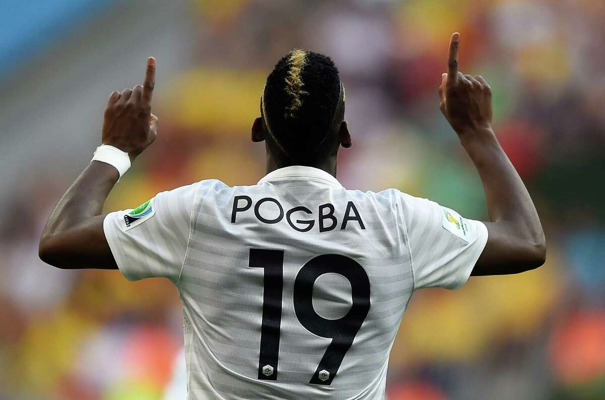 TOPSHOTS France's midfielder Paul Pogba celebrates after scoring the first goal during a Round of 16 football match between France and Nigeria at Mane Garrincha National Stadium in Brasilia during the 2014 FIFA World Cup on June 30, 2014. AFP PHOTO / FABRICE COFFRINIFABRICE COFFRINI/AFP/Getty Images
