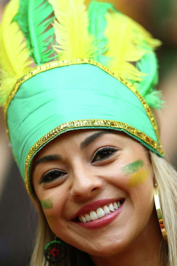 BRASILIA, BRAZIL - JUNE 23:  A Brazil fan enjoys the atmosphere prior to the 2014 FIFA World Cup Brazil Group A match between Cameroon and Brazil at Estadio Nacional on June 23, 2014 in Brasilia, Brazil. Photo: Clive Brunskill, Getty Images / 2014 Getty Images