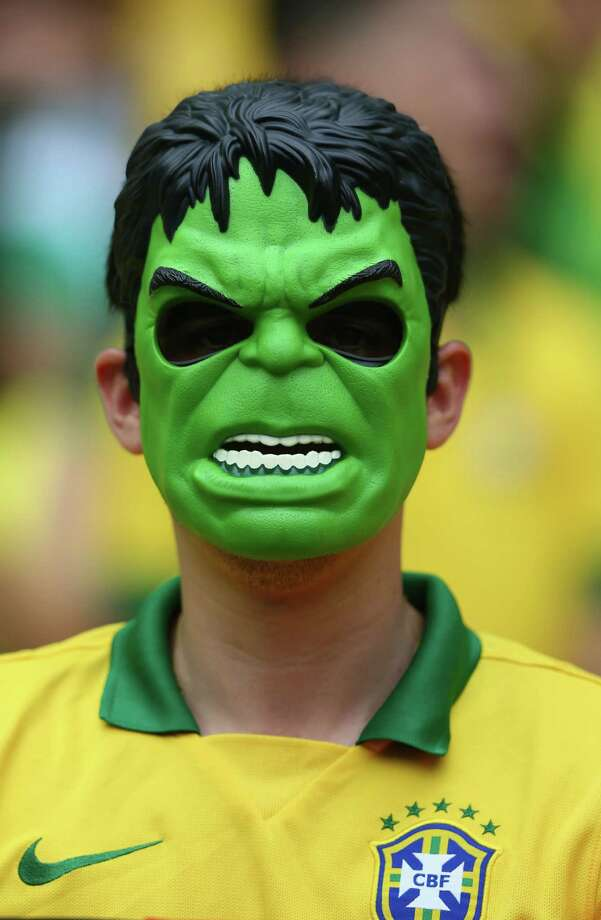 FORTALEZA, BRAZIL - JUNE 17:  A Brazil fan wears a Hulk mask before the 2014 FIFA World Cup Brazil Group A match between Brazil and Mexico at Castelao on June 17, 2014 in Fortaleza, Brazil. Photo: Michael Steele, Getty Images / 2014 Getty Images