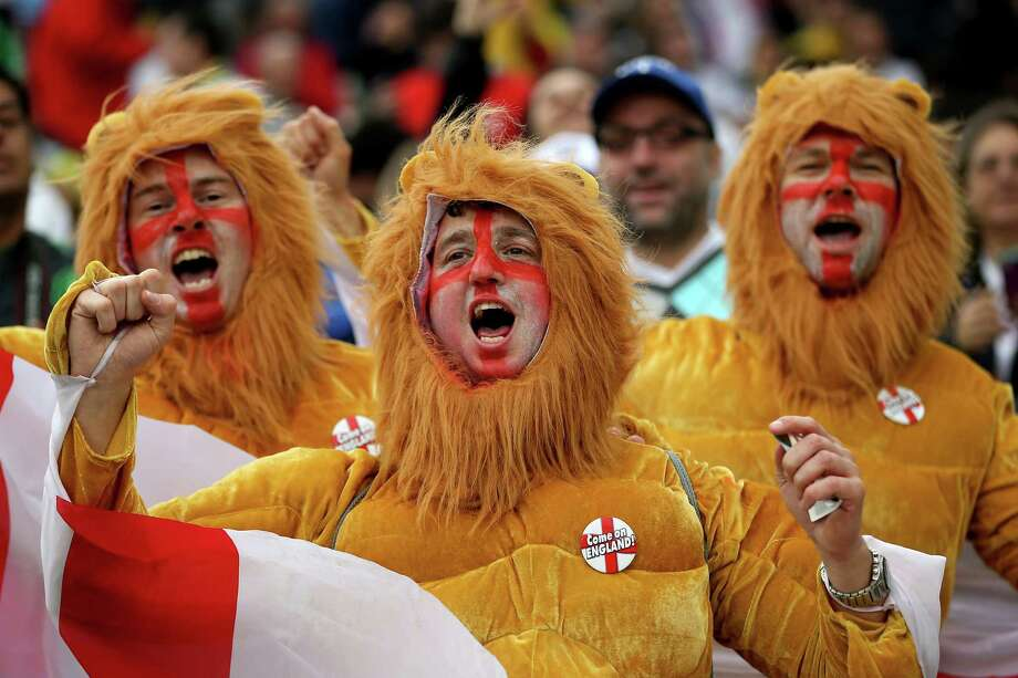 SAO PAULO, BRAZIL - JUNE 19:  England fans dressed up as the Three Lions enjoy the atmosphere prior to the 2014 FIFA World Cup Brazil Group D match between Uruguay and England at Arena de Sao Paulo on June 19, 2014 in Sao Paulo, Brazil. Photo: Richard Heathcote, Getty Images / 2014 Getty Images