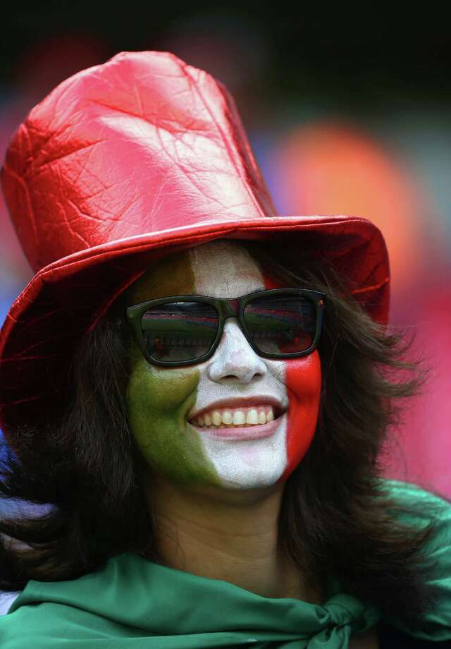RECIFE, BRAZIL - JUNE 20:  An Italy fan poses before the 2014 FIFA World Cup Brazil Group D match between Italy and Costa Rica at Arena Pernambuco on June 20, 2014 in Recife, Brazil. Photo: Robert Cianflone, Getty Images / 2014 Getty Images