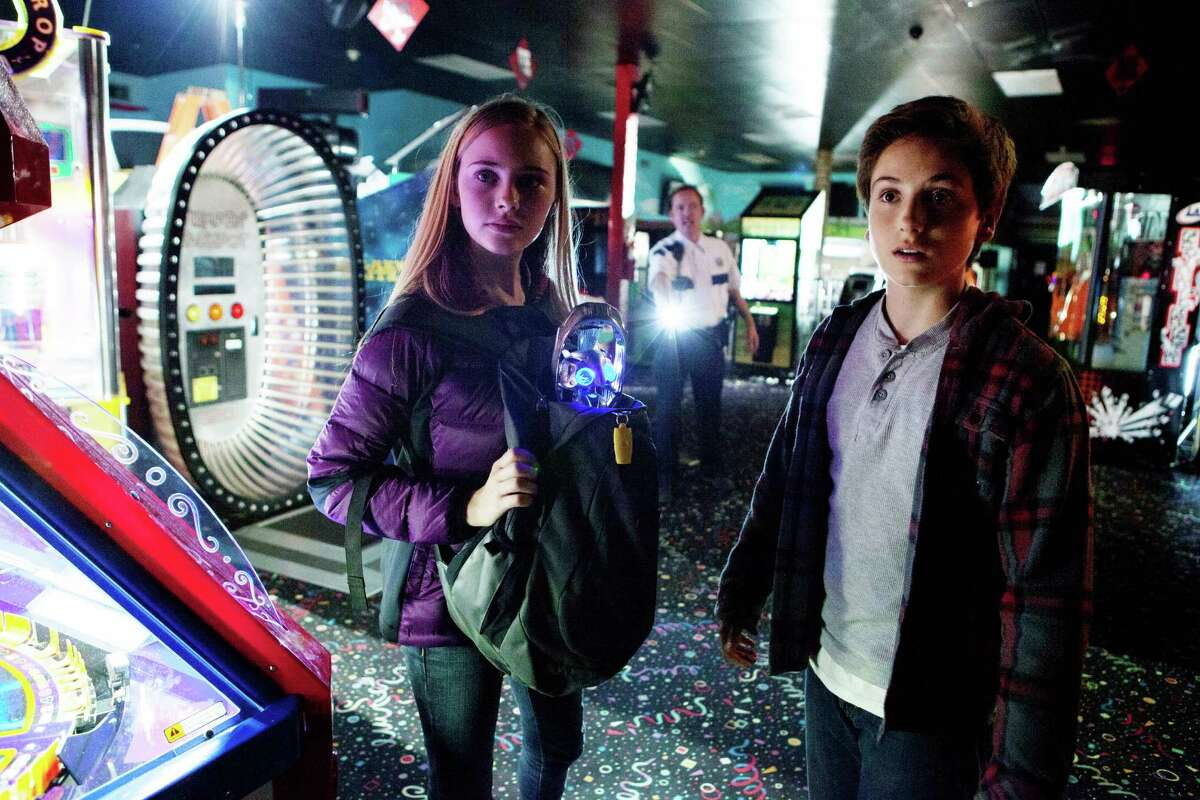 """(Left) ELLA LINNEA WAHLSTEDT (Right) TEO HELM and Echo a small alien who has become stranded on Earth star in Relativity Media's """"EARTH TO ECHO """". ("""