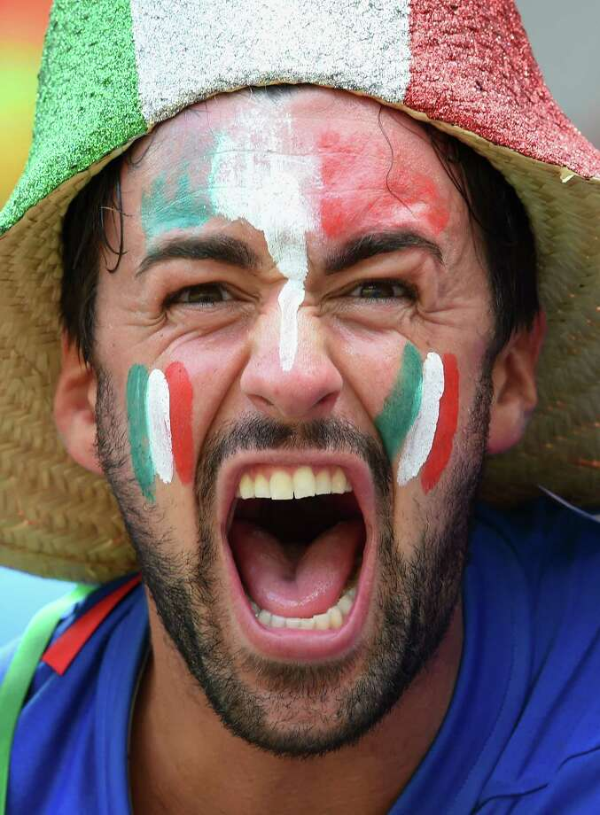 RECIFE, BRAZIL - JUNE 20:  An Italy fan cheers during the 2014 FIFA World Cup Brazil Group D match between Italy and Costa Rica at Arena Pernambuco on June 20, 2014 in Recife, Brazil. Photo: Claudio Villa, Getty Images / 2014 Getty Images