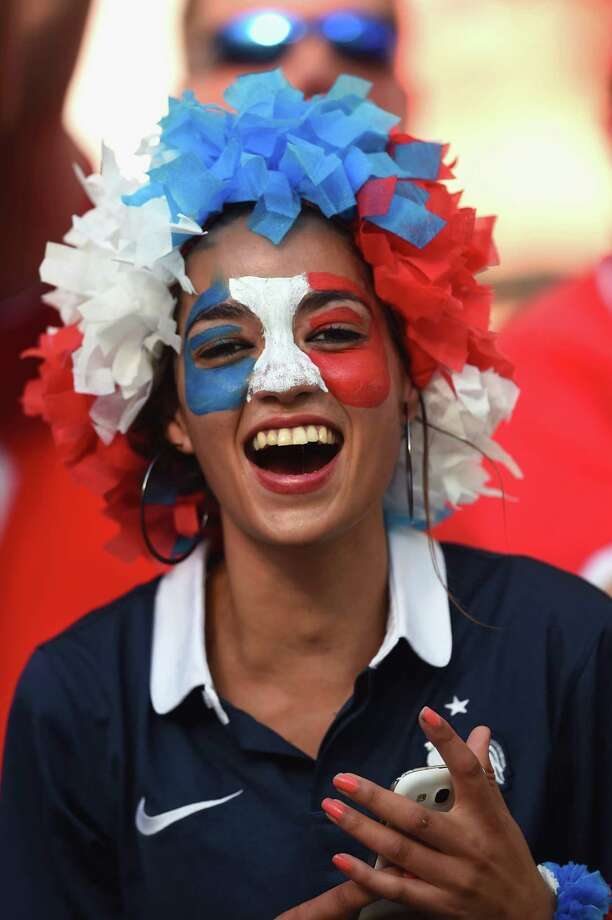 SALVADOR, BRAZIL - JUNE 20:  A France fan smiles during the 2014 FIFA World Cup Brazil Group E match between Switzerland and France at Arena Fonte Nova on June 20, 2014 in Salvador, Brazil. Photo: Christopher Lee, Getty Images / 2014 Getty Images