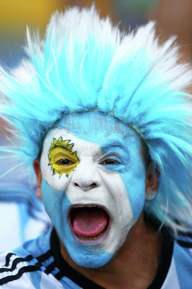 BELO HORIZONTE, BRAZIL - JUNE 21:  An Argentina fan enjoys the atmosphere prior to the 2014 FIFA World Cup Brazil Group F match between Argentina and Iran at Estadio Mineirao on June 21, 2014 in Belo Horizonte, Brazil. Photo: Paul Gilham, Getty Images / 2014 Getty Images