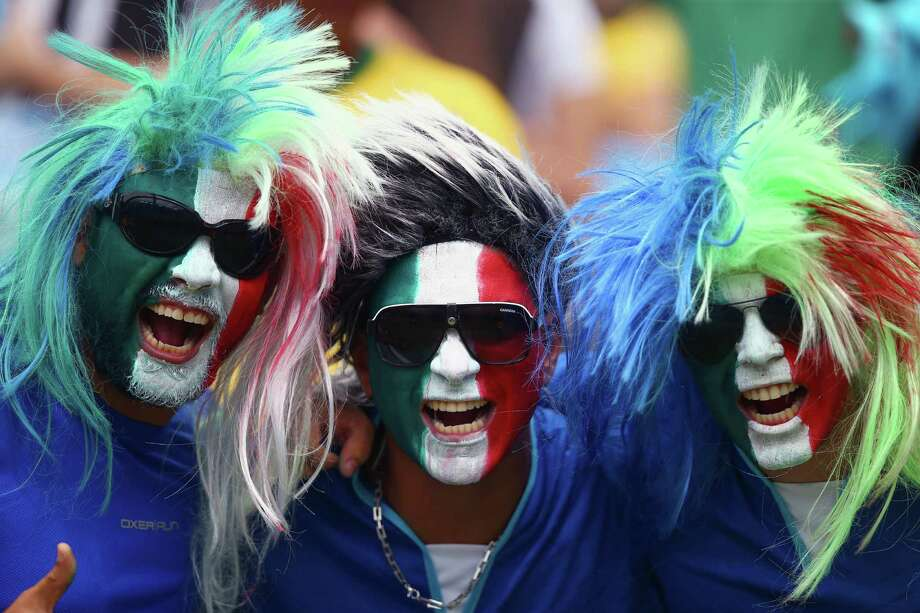 NATAL, BRAZIL - JUNE 24:  Italy fans soak up the pre-match atmopshere during the 2014 FIFA World Cup Brazil Group D match between Italy and Uruguay at Estadio das Dunas on June 24, 2014 in Natal, Brazil. Photo: Clive Rose, Getty Images / 2014 Getty Images