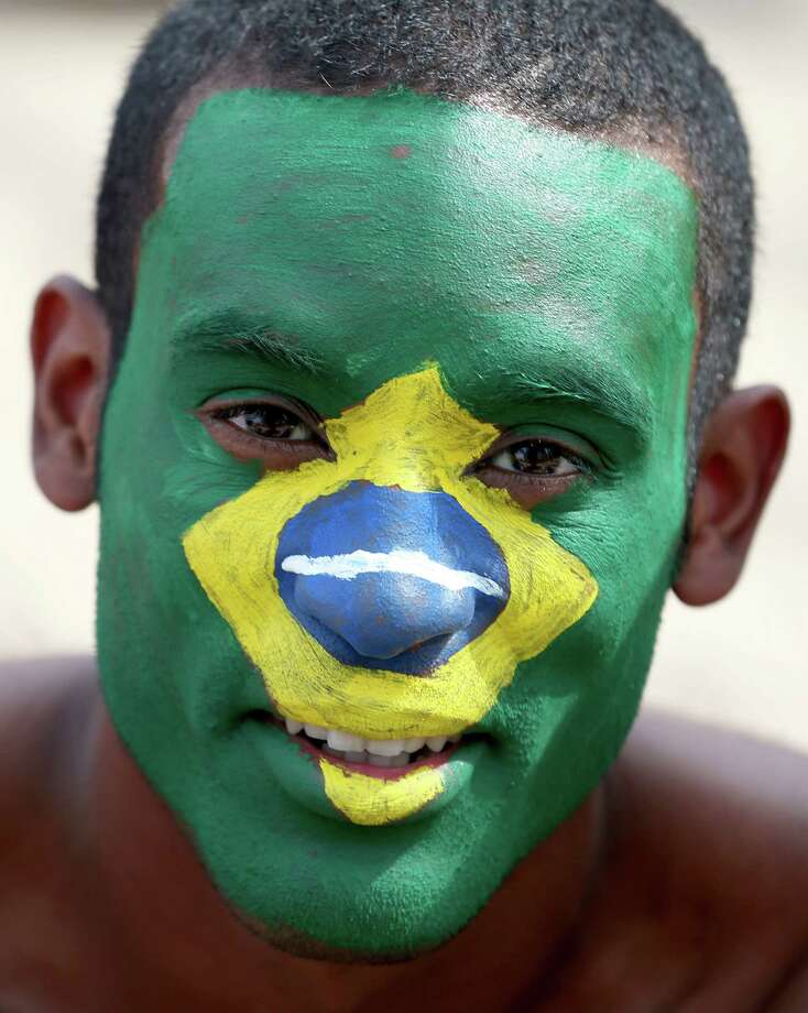 RIO DE JANEIRO, BRAZIL - JUNE 23: A Brazilian soccer fan waits for his team to take the field against Cameroon at the FIFA Fan Fest on Copacabana beach June 23, 2014 in Rio de Janeiro, Brazil. The Netherlands won the match 2-0. Photo: Joe Raedle, Getty Images / 2014 Getty Images