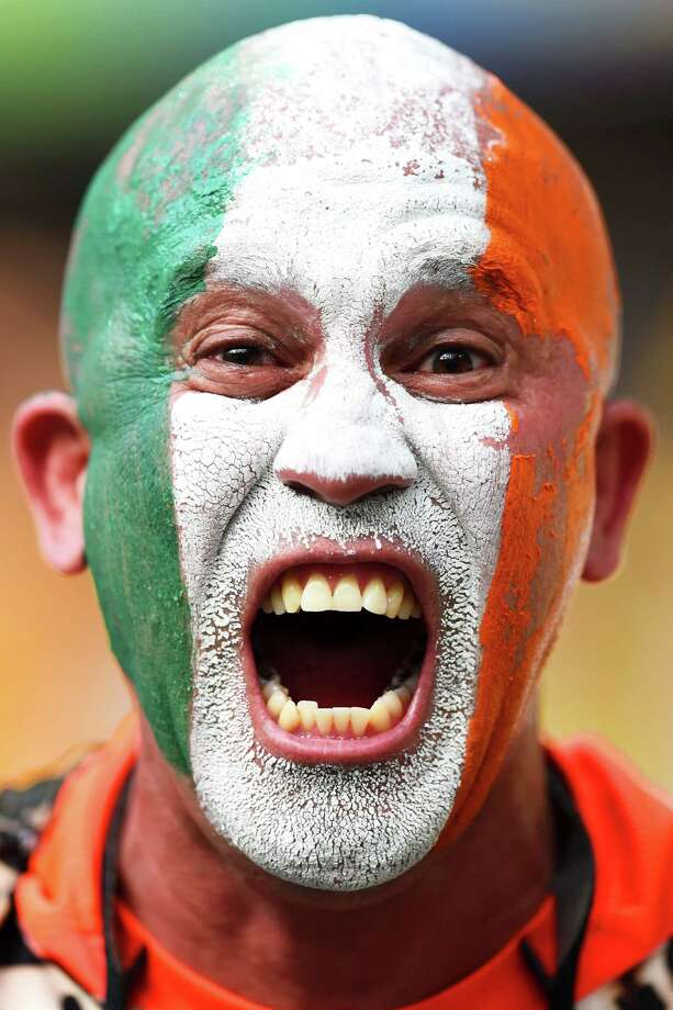 FORTALEZA, BRAZIL - JUNE 24:  An Ivory Coast fan enjoys the atmosphere prior to kickoff during the 2014 FIFA World Cup Brazil Group C match between Greece and the Ivory Coast at Castelao on June 24, 2014 in Fortaleza, Brazil. Photo: Jamie McDonald, Getty Images / 2014 Getty Images