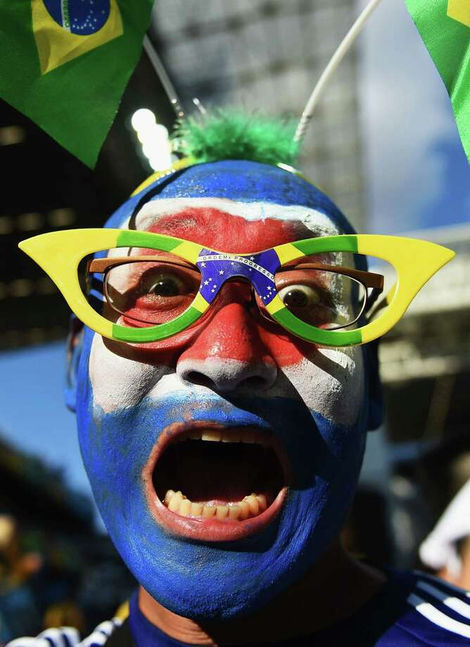 CUIABA, BRAZIL - JUNE 24:  A Japan fan enjoys the atmosphere prior to the 2014 FIFA World Cup Brazil Group C match between Japan and Colombia at Arena Pantanal on June 24, 2014 in Cuiaba, Brazil. Photo: Christopher Lee, Getty Images / 2014 Getty Images