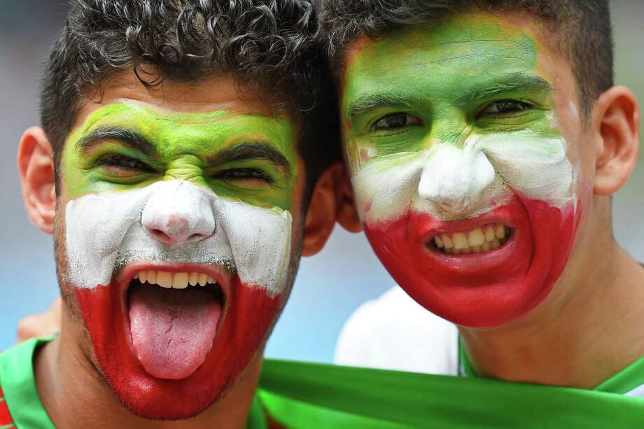 SALVADOR, BRAZIL - JUNE 25:  Iran fans pose during the 2014 FIFA World Cup Brazil Group F match between Bosnia and Herzegovina and Iran at Arena Fonte Nova on June 25, 2014 in Salvador, Brazil. Photo: Jamie McDonald, Getty Images / 2014 Getty Images