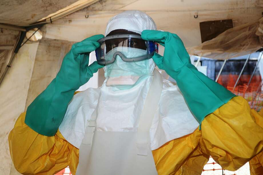 Deadly outbreak:A member of Doctors Without Borders puts on protective gear in the isolation ward of Donka   Hospital in Conakry, Guinea, where victims of the Ebola virus are being treated. The World   Health Organization has warned that Ebola could spread beyond hard-hit Guinea, Liberia and   Sierra Leone to neighboring nations. To date,   there have been 635 cases of hemorrhagic fever in the three countries, most   confirmed as Ebola. A total of 399 people have died. Photo: Cellou Binani, AFP/Getty Images