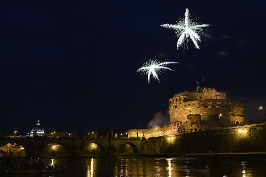 "Roman 'candles': Fireworks burst over the Tiber River and the Castel Sant'Angelo during the traditional ""Girandola,"" the feast of Rome's patron saints, Peter and Paul. Photo: Tiziana Fabi, AFP/Getty Images"
