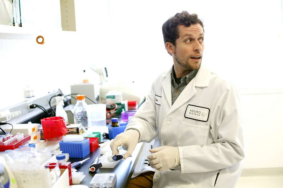 Scientist Chris Rae tries to isolate a protein at Aduro Biotech in Berkeley, which trying to develop cancer vaccines. Photo: Sarah Rice, Special To The Chronicle
