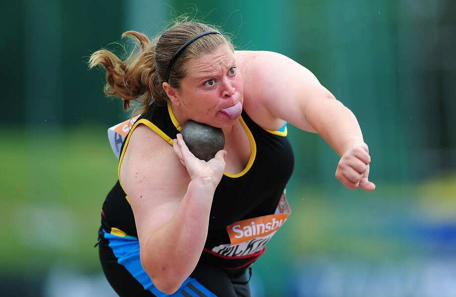 Britain's new Iron Lady: Sophie McKinna grimaces as she puts the shot at the Sainsbury's British Championships in 