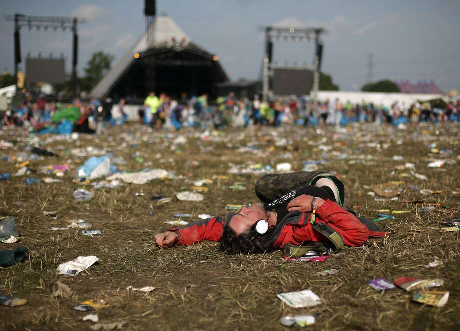And the band played on in his head: The Glastonbury Festival may be over for most music fans, but not this festival-goer on Worthy Farm near the English town. Photo: Yui Mok, Associated Press