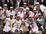 The Spurs won the NBA Championship! Click through to relive their season.   The San Antonio Spurs pose with the O'Brien Trophy after winning Game 5 against the Miami Heat at the 2014 NBA Finals at the AT&T Center on Sunday, June 15, 2014.