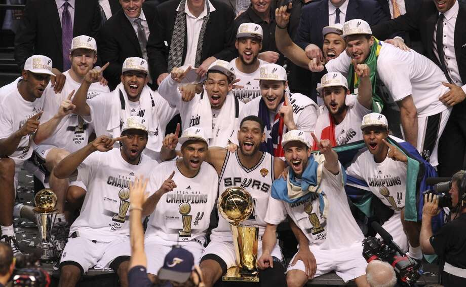 The Spurs won the NBA Championship! Click through to relive their season.The San Antonio Spurs pose with the O'Brien Trophy after winning Game 5 against the Miami Heat at the 2014 NBA Finals at the AT&T Center on Sunday, June 15, 2014. Photo: Kin Man Hui, San Antonio Express-News