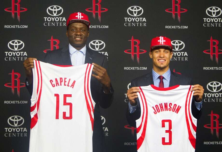 Rockets draft picks Clint Cappela, left, and Nick Johnson display their jerseys during a news conference at Toyota Center on Monday. Photo: Cody Duty, Houston Chronicle