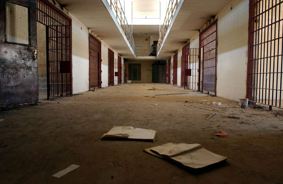 Empty cells inside Abu Ghraib prison are shown in this view from April 2003. The facility near Baghdad became notorious when photos depicting American soldiers abusing detainees were released in 2004. Photo: Marco Di Lauro, Getty Images