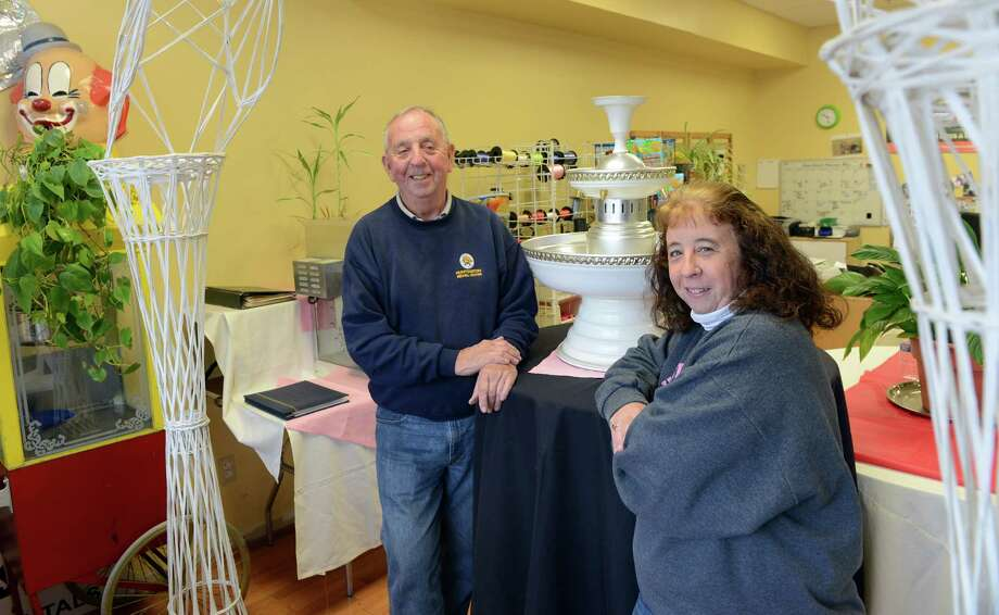 Father/daughter business partners Bob Lally and Kathy Albert run Huntington Rental Center in the White Hills shopping center in Shelton where they rent party items including bounce houses, water slides and tents as well as chocolate fountains and cotton candy machines. Photo: Autumn Driscoll / Connecticut Post
