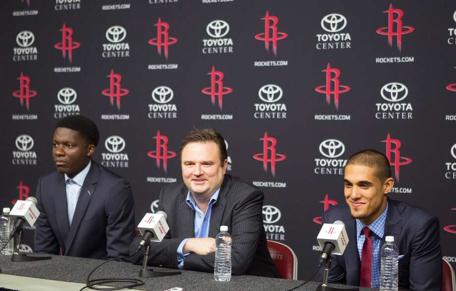 Clint Cappela, left, Rockets GM Daryl Morey, center, and Nick Johnson, right, answer questions during the news conference. Photo: Cody Duty, Houston Chronicle