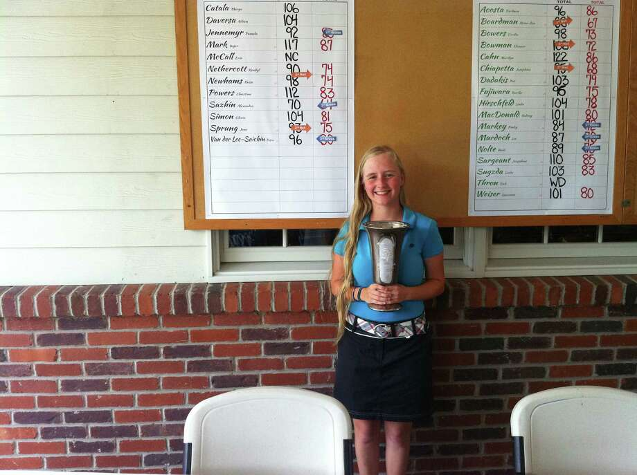 Alexandra Sazhin poses with her trophy after winning the Townwide flight of the Ladies Town Golf Tournament Monday at Griffith E. Harris Golf Course in Greenwich. Sazhin's round of 70 tied a course record for woman in the tournament. Photo: David Fierro / Greenwich Time