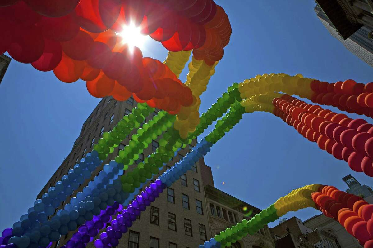 NEW YORK, NY - JUNE 29: Balloons are seen down 5th Avenue during the 2014 Gay Pride March on June 29, 2014 in New York City. Thousands of marchers attended the parade route, which started at 36th Street and Fifth Avenue and ended at Greenwich and Christopher streets. The parade ended at the Stonewall Inn, where New York marchers commemorated the 45th anniversary of the 1969 riots, which are credited with launching the modern gay rights movement. New York Gov. Andrew Cuomo and New York City's Mayor Bill de Blasio were in attendance along with grand marshals Laverne Cox, transgender actress and activist, actor Jonathan Groff and Rea Carey, Executive Director of the National Gay and Lesbian Task Force. ORG XMIT: 498689243