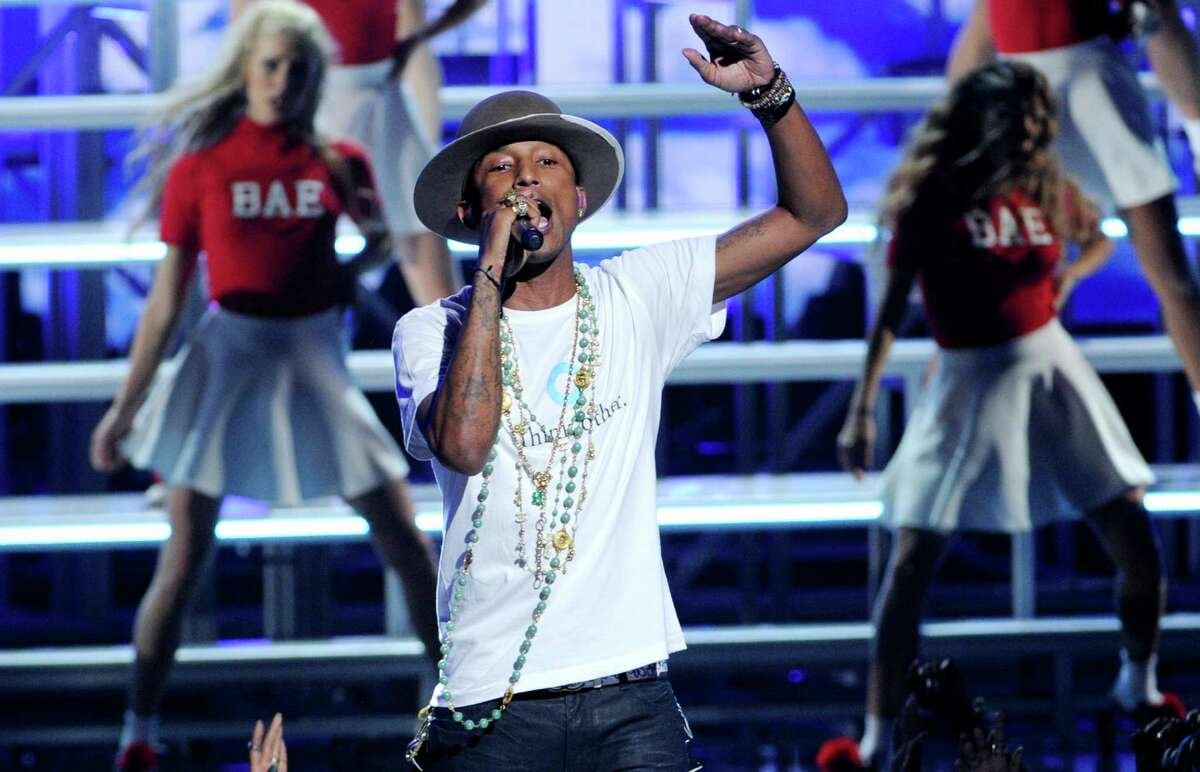 Pharrell Williams performs at the BET Awards at the Nokia Theatre on Sunday, June 29, 2014, in Los Angeles. (Photo by Chris Pizzello/Invision/AP) ORG XMIT: CABR138