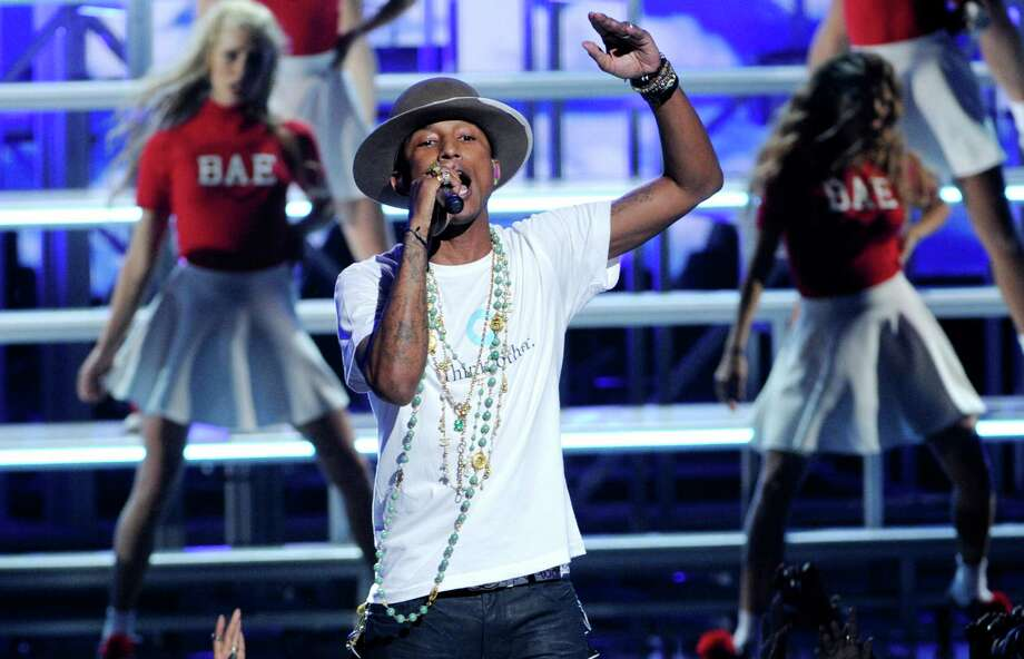 Pharrell Williams performs at the BET Awards at the Nokia Theatre on Sunday, June 29, 2014, in Los Angeles. (Photo by Chris Pizzello/Invision/AP) ORG XMIT: CABR138 Photo: Chris Pizzello, AP / Invision