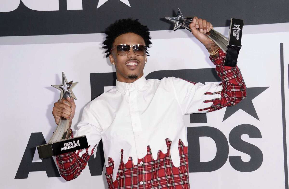 """August Alsina, winner of the viewers choice award for """"I Luv This"""" featuring Trinidad Jame$ and the award for best new artist, poses in the press room at the BET Awards at the Nokia Theatre on Sunday, June 29, 2014, in Los Angeles. (Photo by Dan Steinberg/Invision/AP) ORG XMIT: CABR234"""
