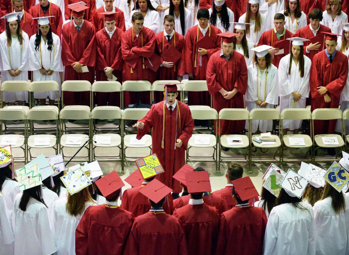 Joseph Sipzner, center, conducts the Concert Choir Seniors as they perform the National Anthem at Guilderland High School Commencement ceremonies at SEFCU Arena Saturday June 28, 2014, in Albany, NY. (John Carl D'Annibale / Times Union)