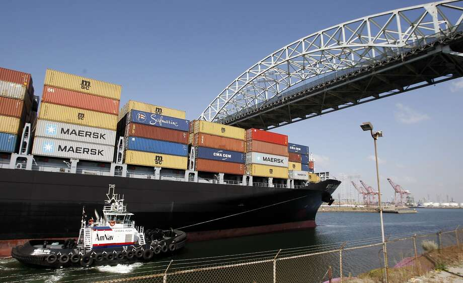 A cargo ship enters the Port of Long Beach under the Gerald Desmond Bridge, which is to be replaced. Photo: Chris Carlson, Associated Press