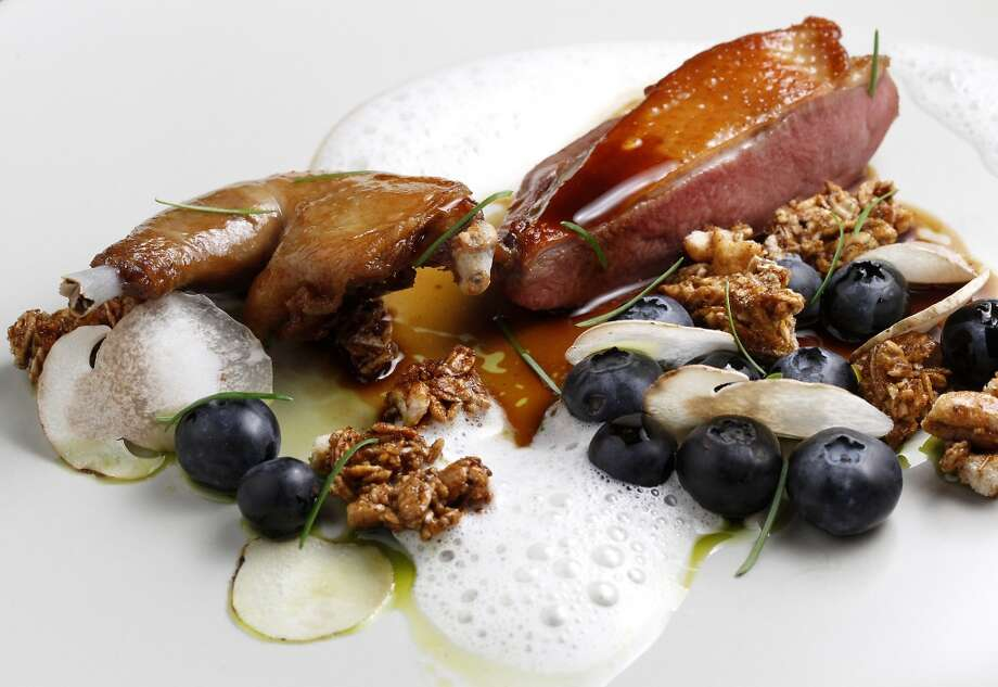 Squab breast and squab leg with blueberries, fir tip oil, and porcini granola at Lazy Bear. Photo: Sarah Rice, Special To The Chronicle