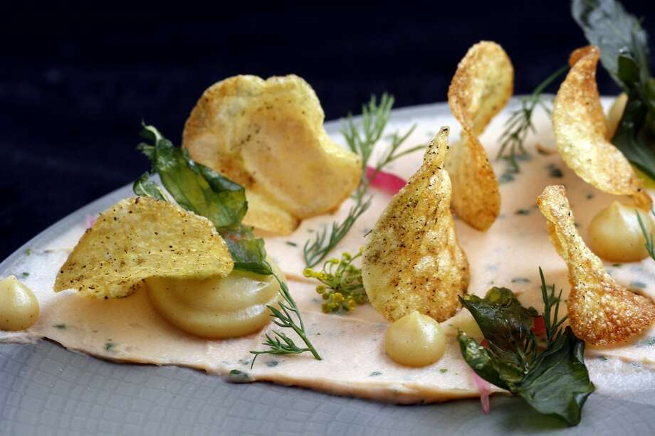 Salmon mousse with potato chips, caramelized lemon puree, dill fronds and fried lovage at Lazy Bear. Photo: Sarah Rice, Special To The Chronicle