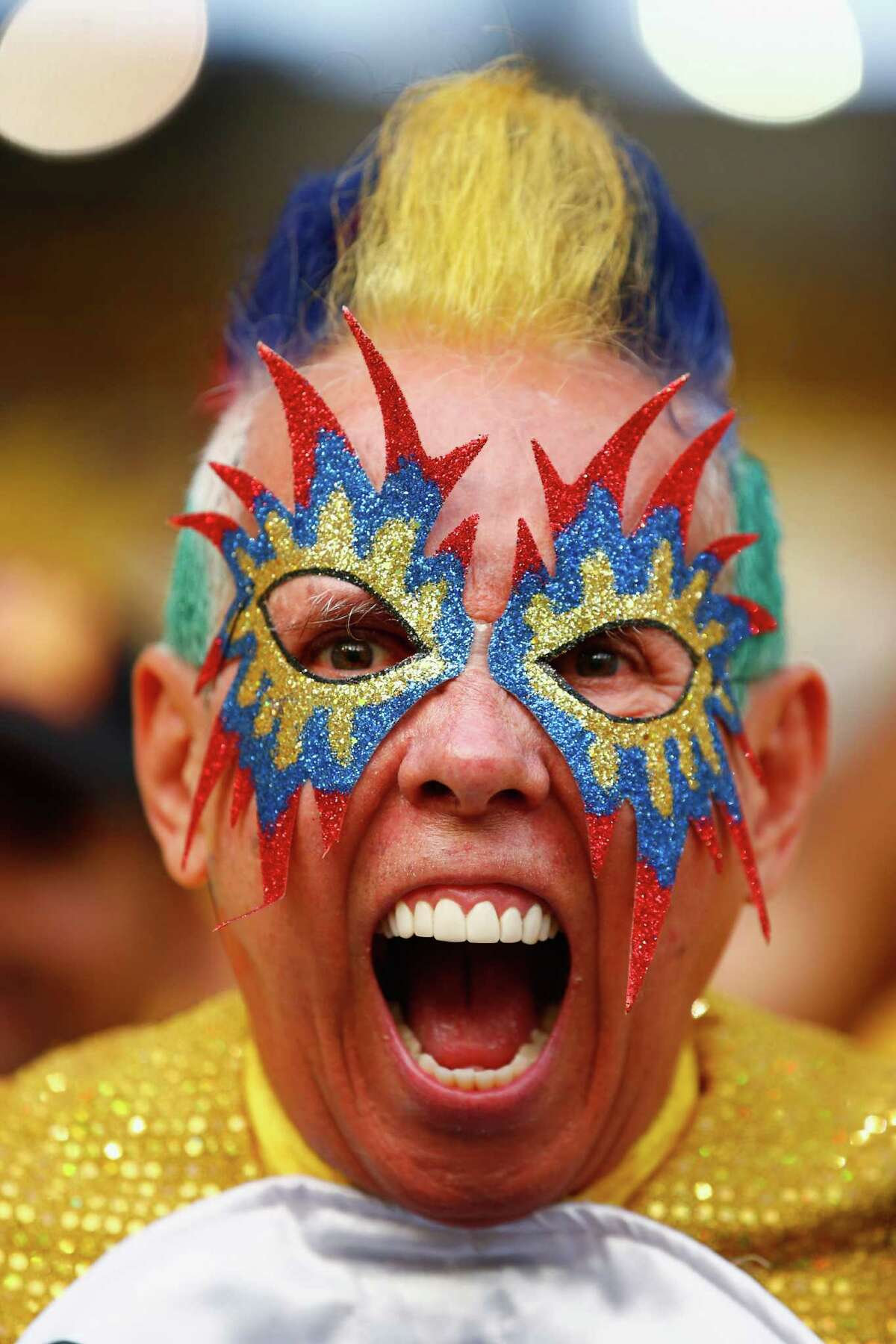 RIO DE JANEIRO, BRAZIL - JUNE 28: A Colombian fan shows his colours ahead of the 2014 FIFA World Cup Brazil round of 16 match between Colombia and Uruguay at Maracana on June 28, 2014 in Rio de Janeiro, Brazil.