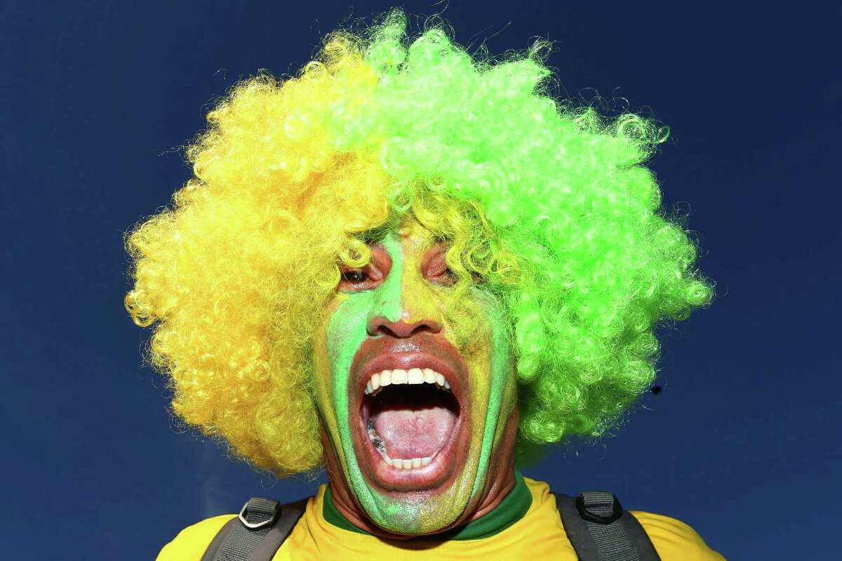 BELO HORIZONTE, BRAZIL - JUNE 28: A Brasil fan enjoys atmosphere prior to kickoff during the 2014 FIFA World Cup Brazil round of 16 match between Brazil and Chile at Estadio Mineirao on June 28, 2014 in Belo Horizonte, Brazil.