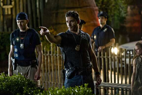 "This image released by Sony Pictures shows Joel McHale, left, and Eric Bana in a scene from Screen Gems' ""Deliver Us From Evil."" (AP Photo/Sony Pictures, Andrew Schwartz)"