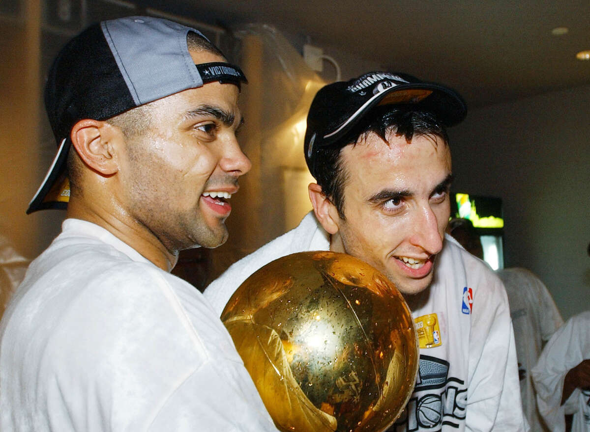 Spurs guards Tony Parker, then 21 and in his second season, and Manu Ginobili, a 25-year-old rookie, celebrate their first NBA championship moment together after eliminating the Nets in six games. Tony Parker is leaving the Spurs for the Hornets after 17 seasons and 4 titles.